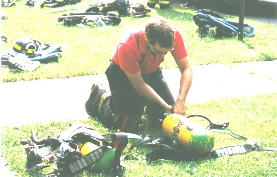 Me changing breathing air tanks at a house fire some years ago, just to show I could once use both arms.