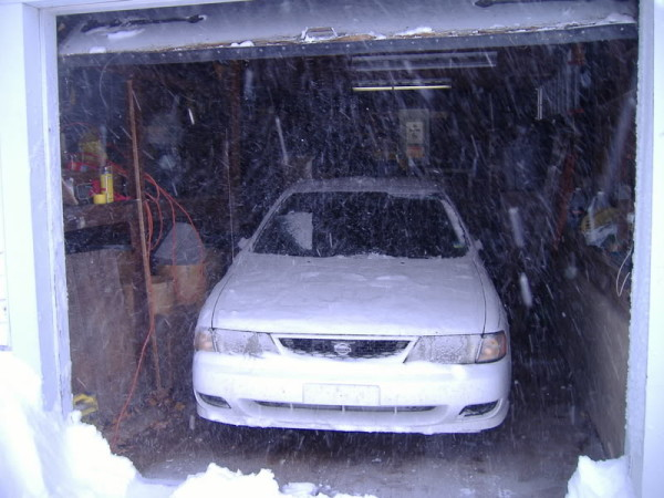 My garage in better days … well, before I got a better car, anyway. Notice the door is already tired.